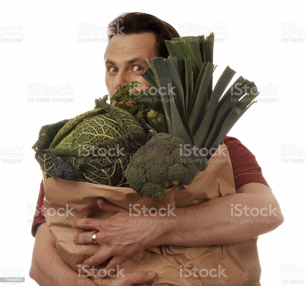 man holding bag full of vegetables royalty-free stock photo