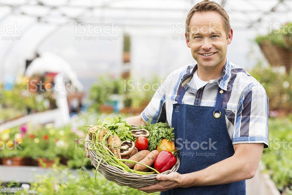 Man Holding Basket Of Fresh Vegetables royalty-free stock photo