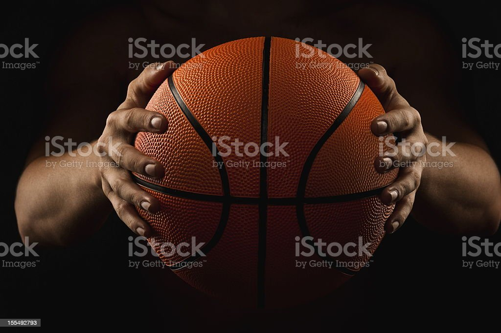 Man holding basketball in the dark royalty-free stock photo