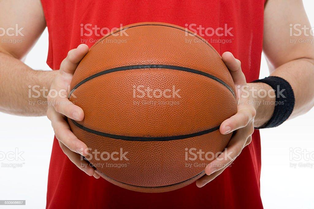 Man holding basketball stock photo