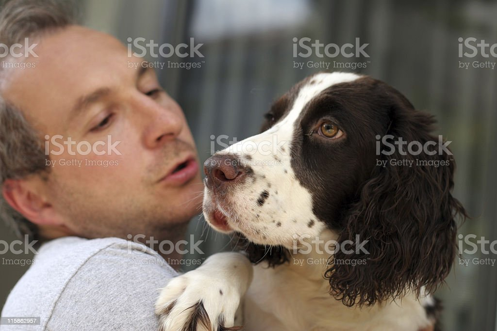 Man holding black and white dog royalty-free stock photo