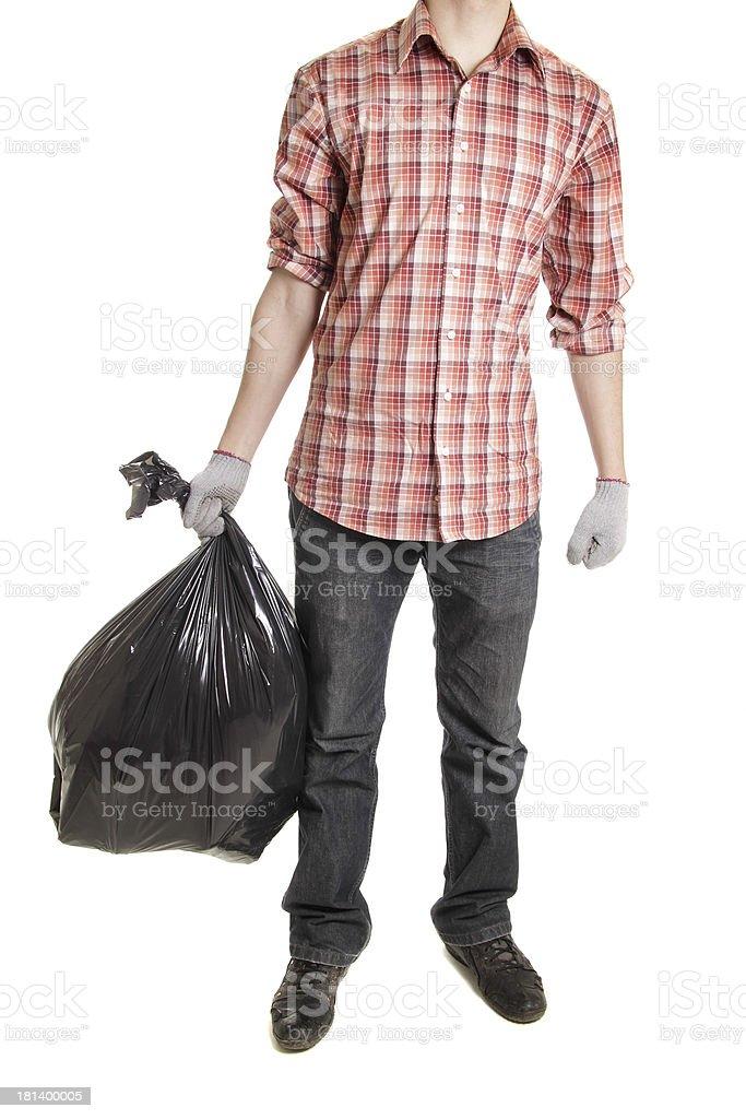 Man holding black plastic trash bag stock photo