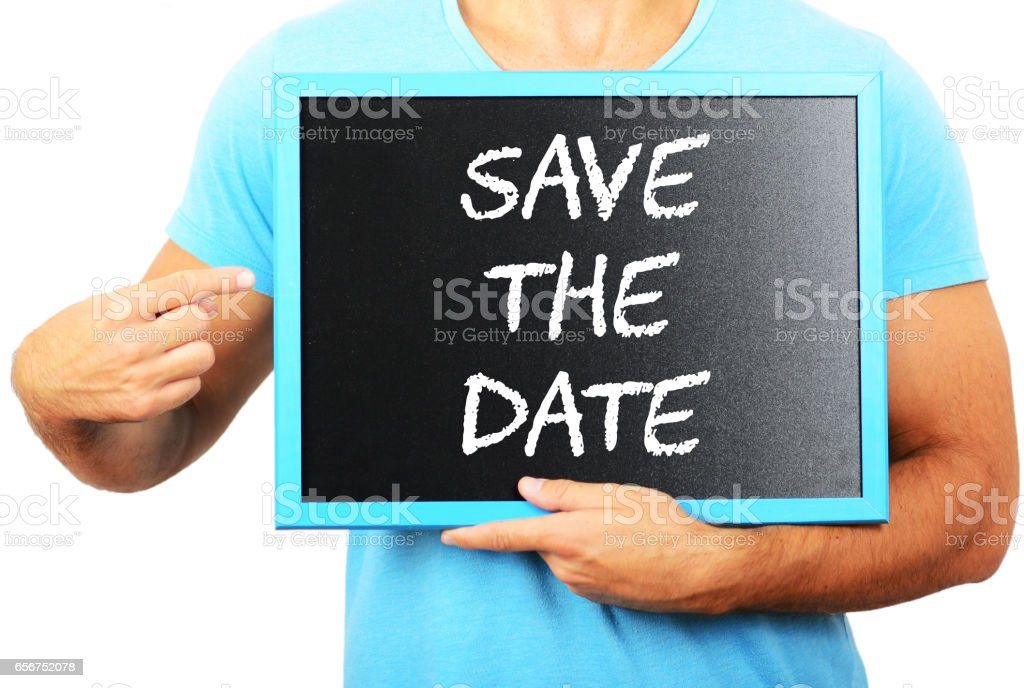 Man holding blackboard in hands and pointing the word SAVE THE DATE stock photo