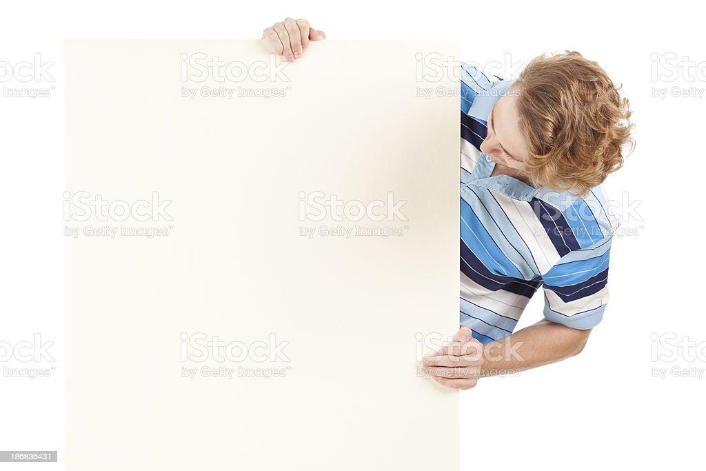 Man holding blank billboard royalty-free stock photo