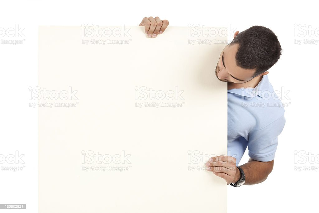 Man holding blank billboard. royalty-free stock photo