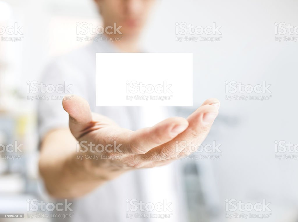 Man holding blank business card with copy space, small dof royalty-free stock photo