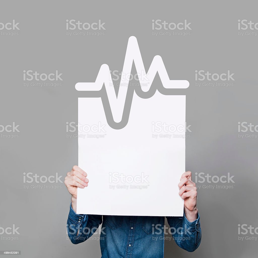 Man holding blank heart rate poster stock photo
