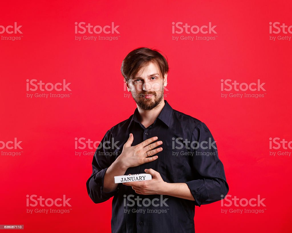 Man holding blank with name of month January stock photo