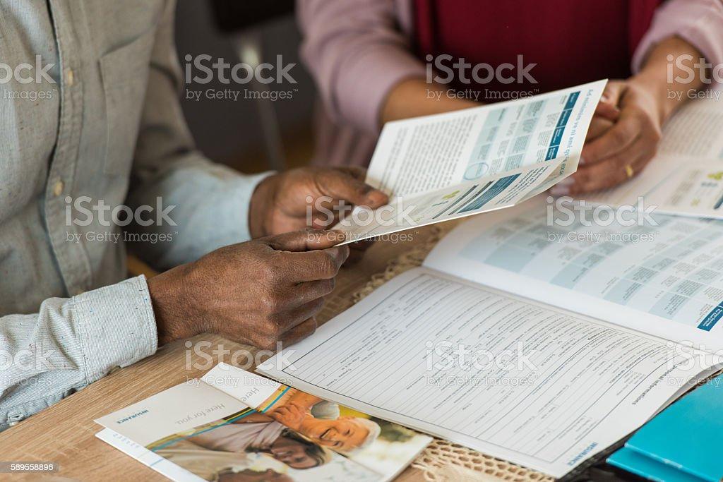 Man holding brochure stock photo