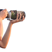 Man holding camera with telezoom lens isolated on white