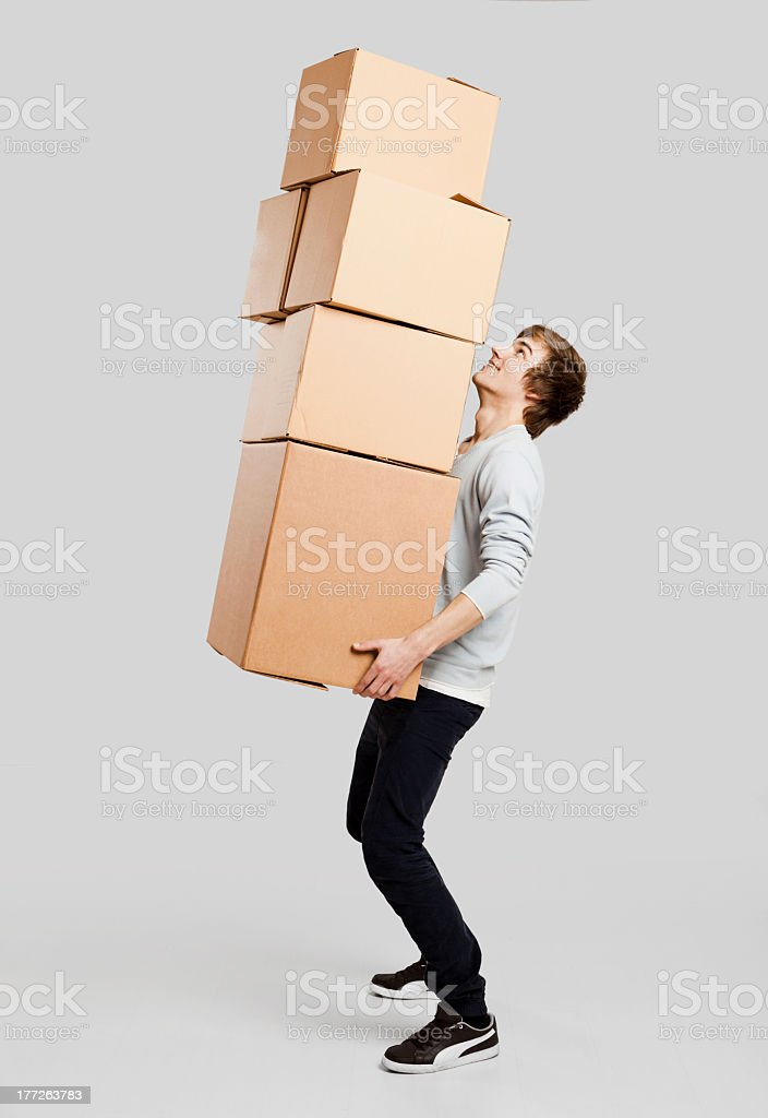 Man holding card boxes stock photo