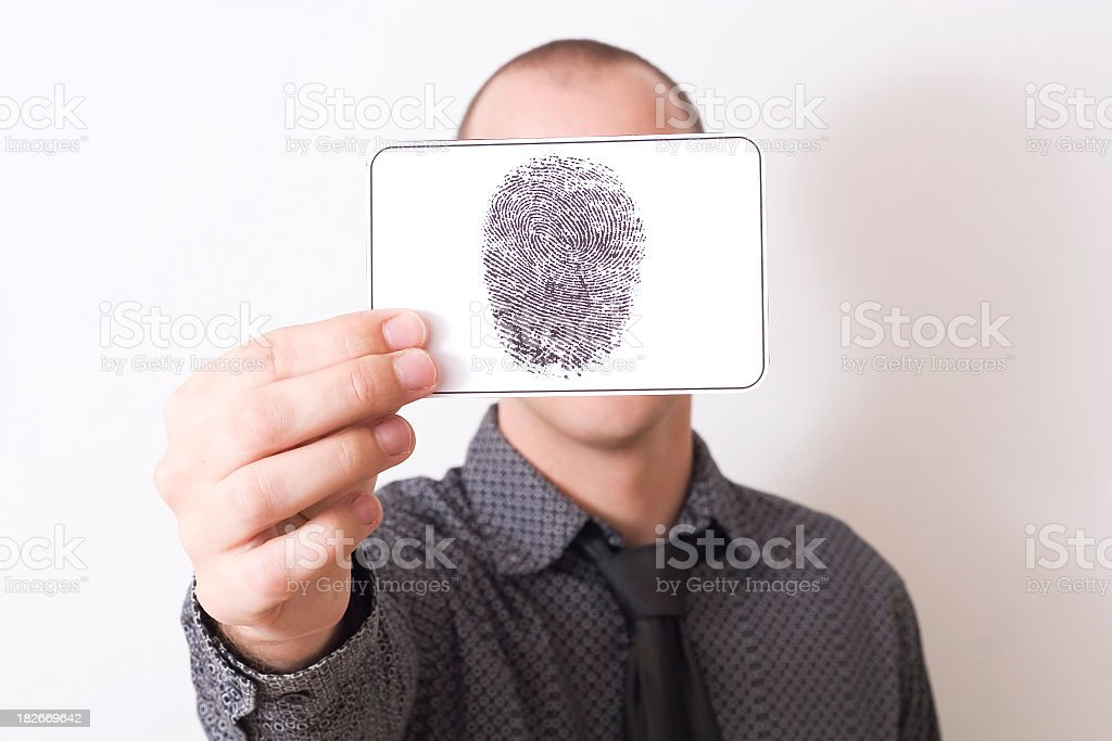 Man holding card with a fingerprint on in front of his face royalty-free stock photo
