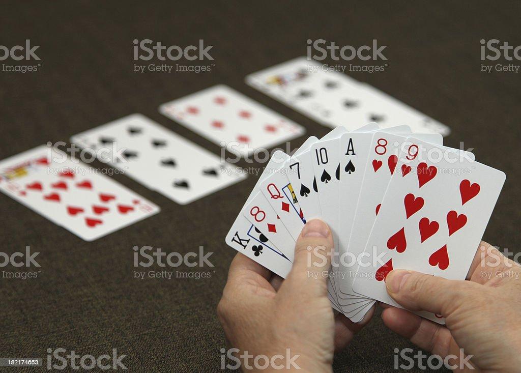 Man holding cards while playing bridge stock photo