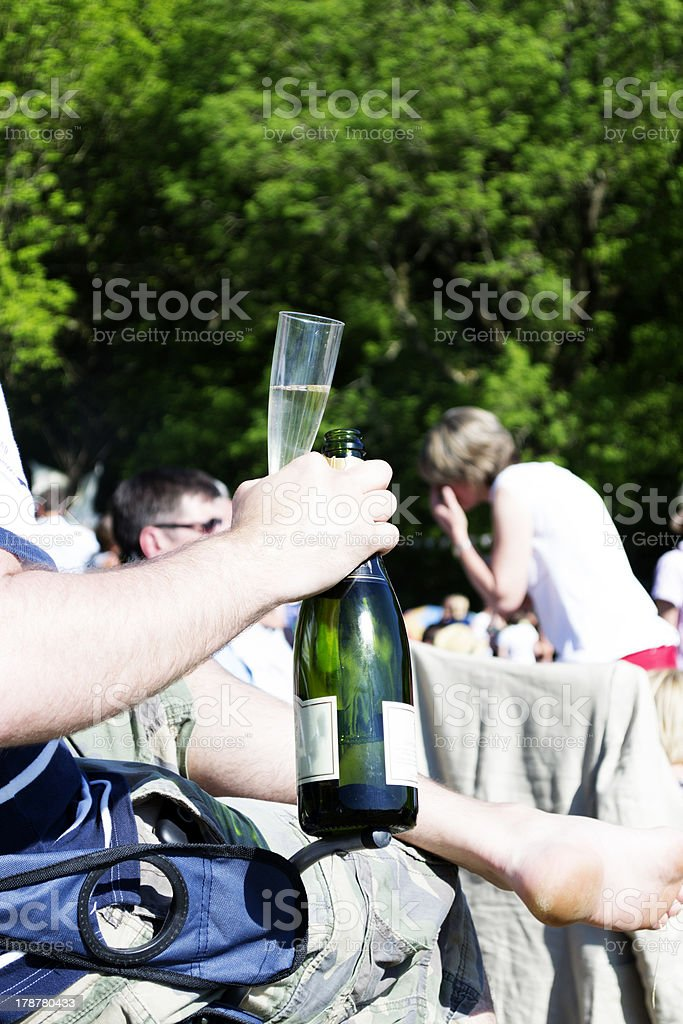 Man holding champagne glass and bottle royalty-free stock photo