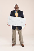 A man holding cheque