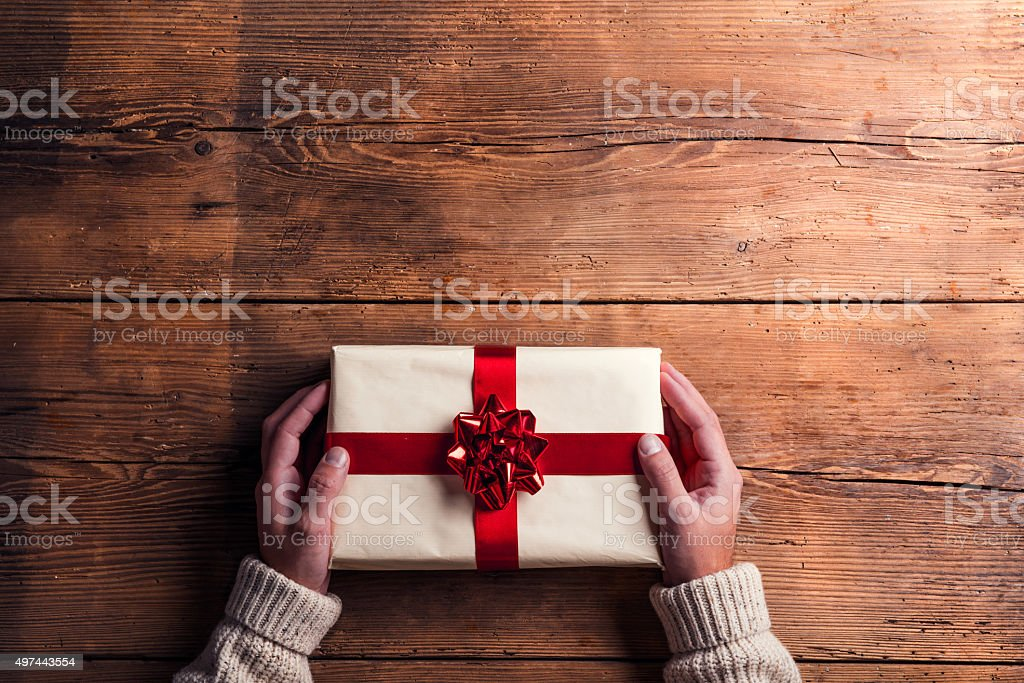 Man holding Christmas present stock photo