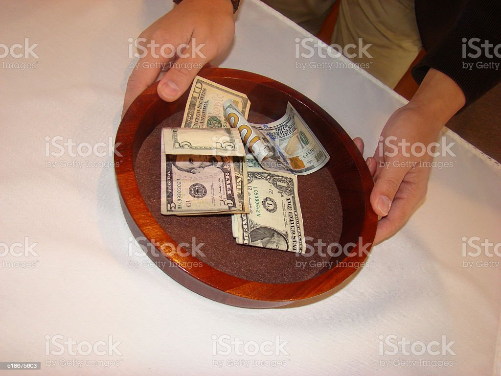 Man holding Church Collection Plate stock photo
