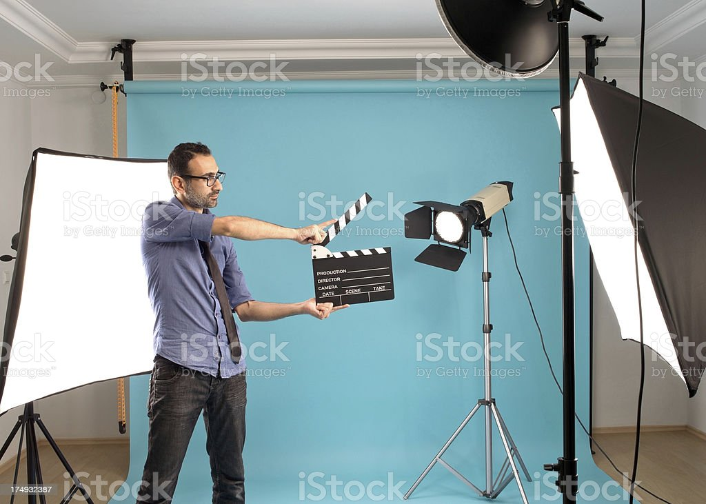 Man holding clapper in studio royalty-free stock photo