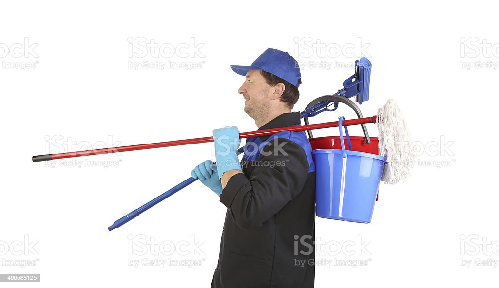 Man holding cleaning supplies. stock photo