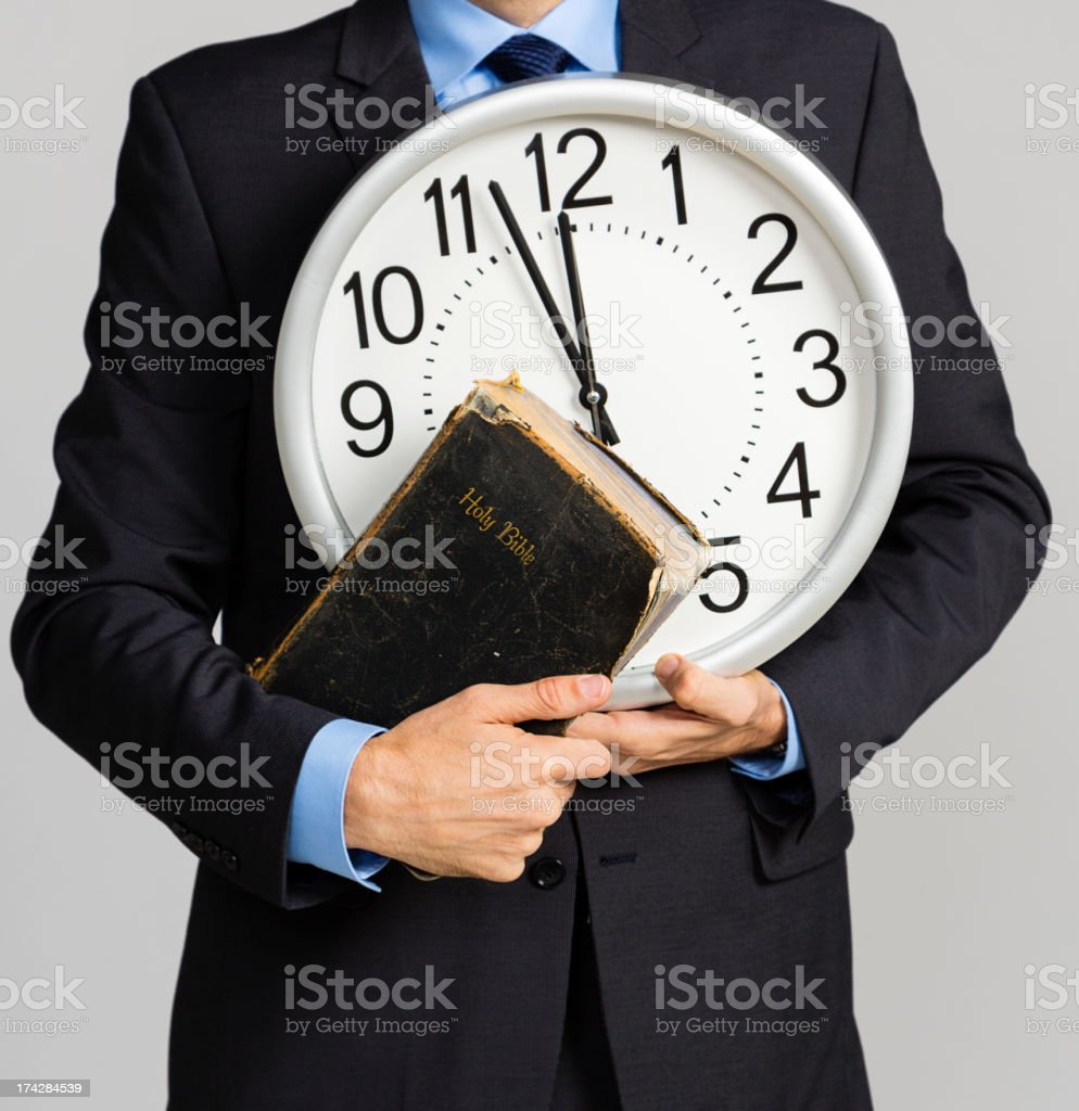 Man Holding Clock and Bible stock photo
