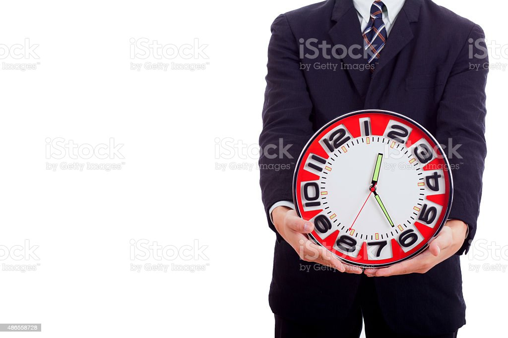 Man holding clock hands. stock photo