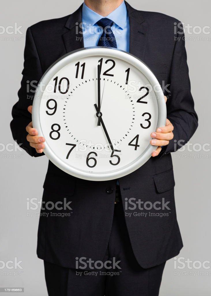 Man Holding Clock stock photo