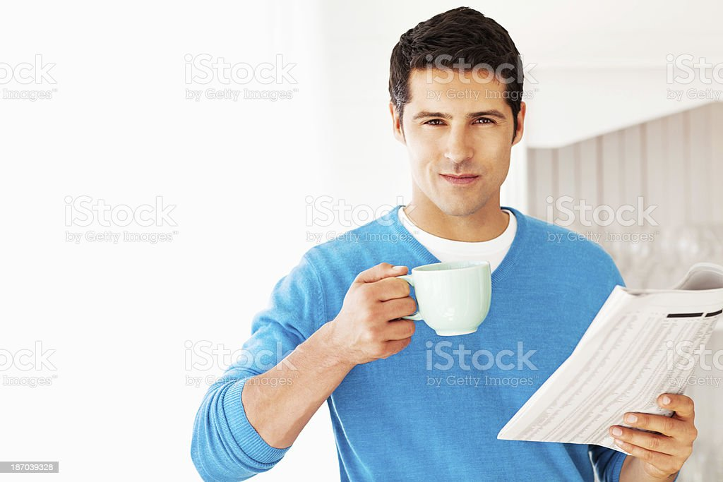 Man Holding Coffee Cup And Newspaper royalty-free stock photo