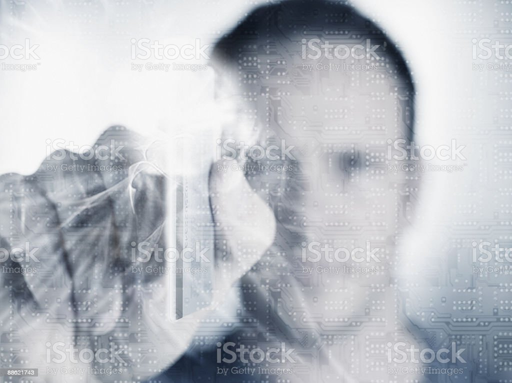 Man holding credit card with microchip in foreground royalty-free stock photo