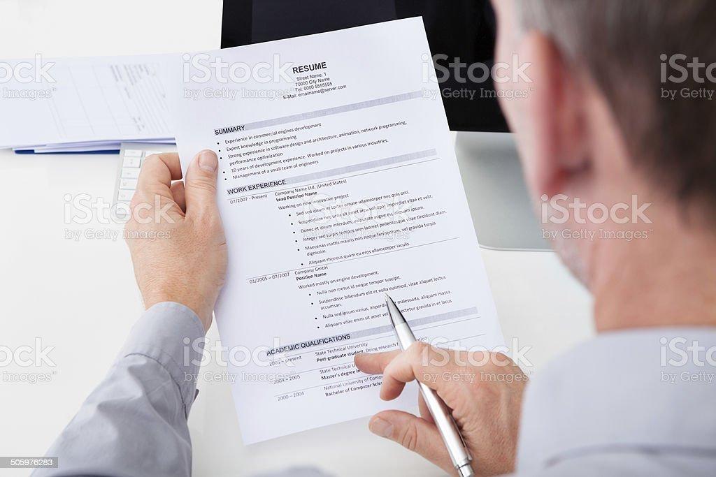 Man Holding Curriculum Vitae stock photo