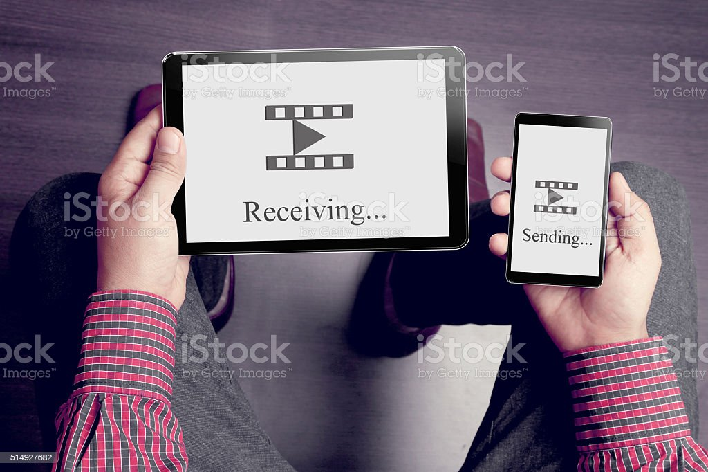 Man holding digital tablet and smart phone stock photo