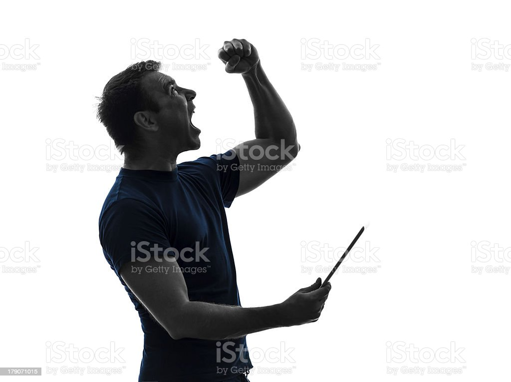 man holding digital tablet happy joy silhouette royalty-free stock photo