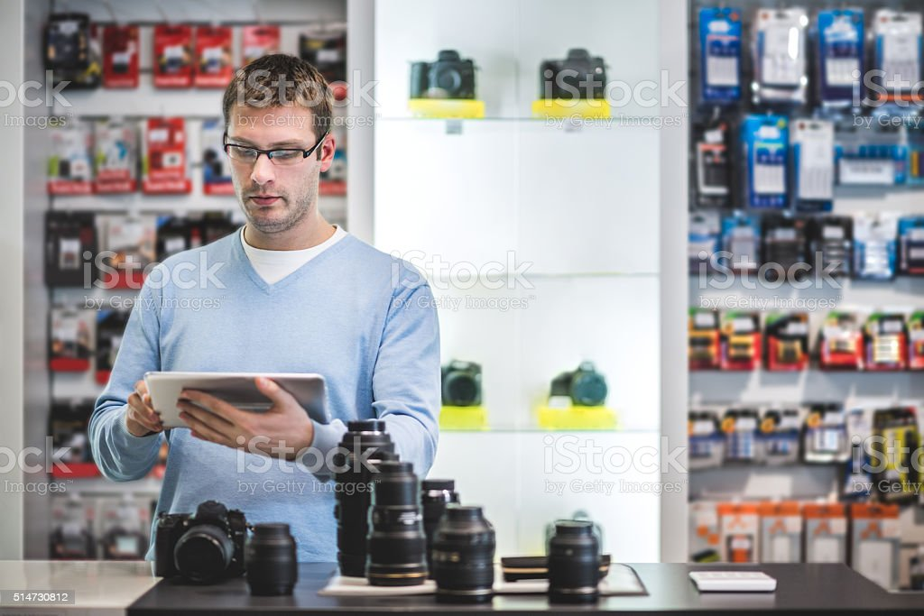 Man holding digital tablet in the store stock photo
