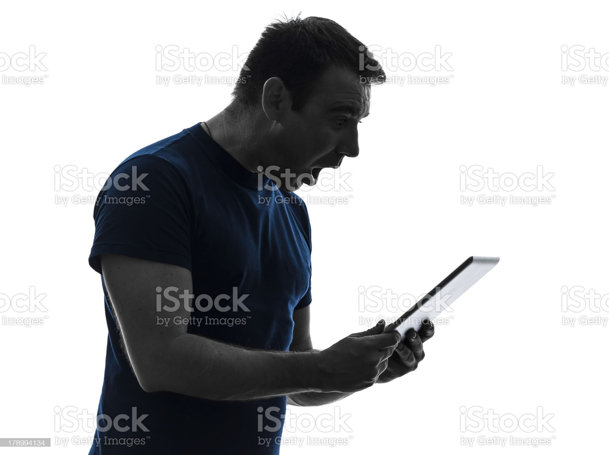 man holding digital tablet surprised silhouette royalty-free stock photo