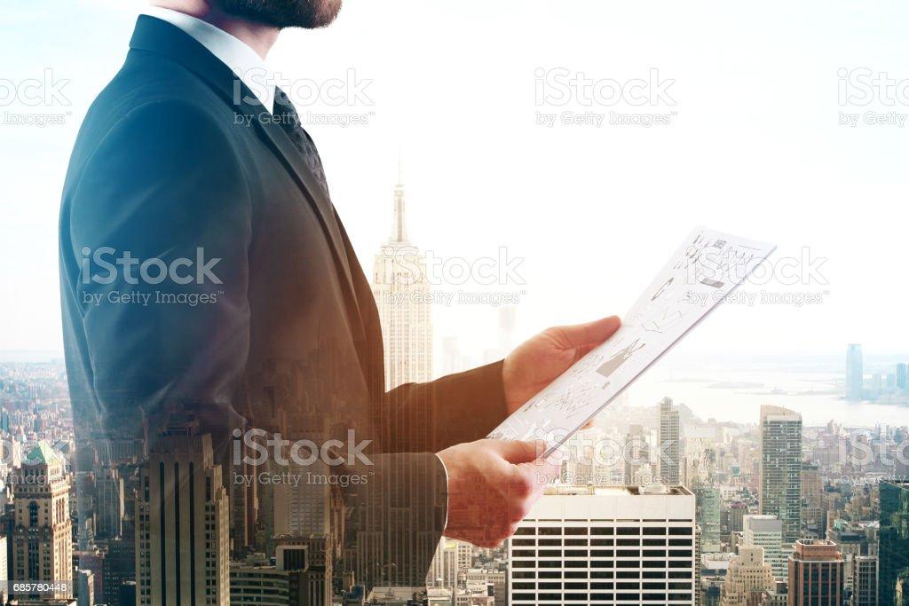 Man holding document multiexposure stock photo
