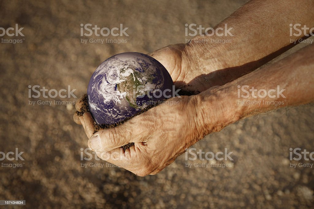 Man Holding Earth in Hands royalty-free stock photo