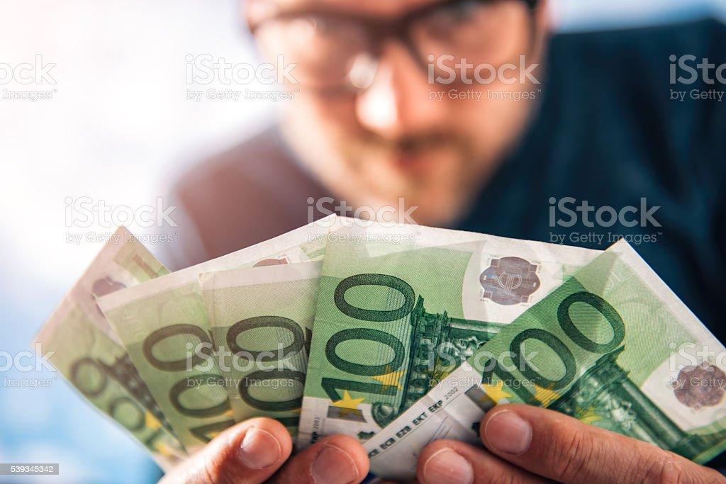 Man Holding European Money stock photo