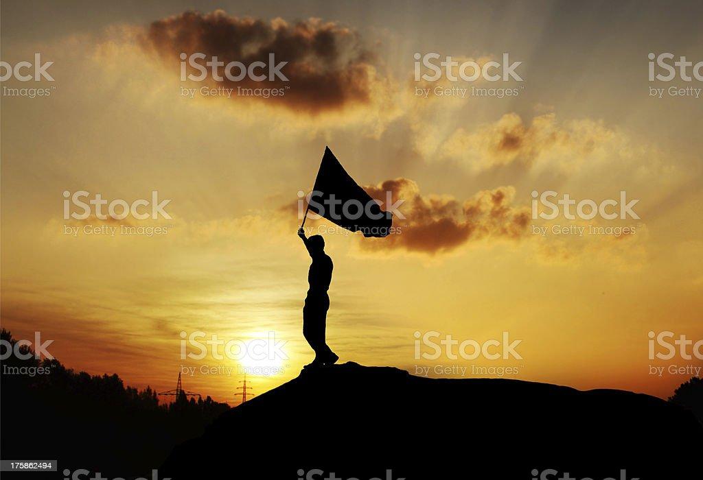 Man holding Flag at Sunset stock photo
