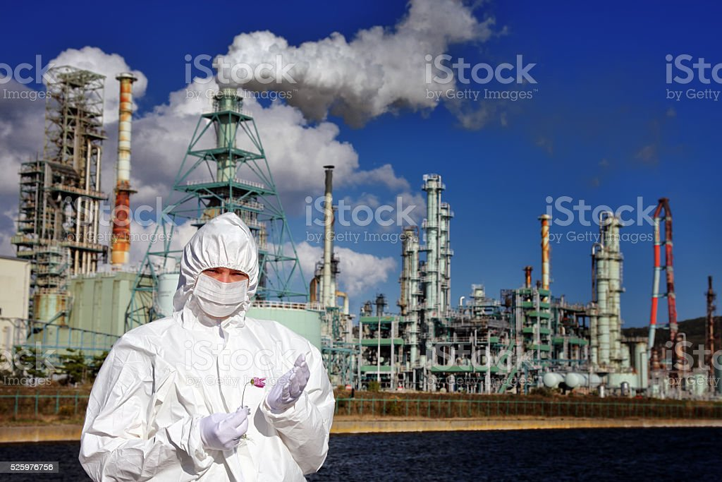 Man holding flower in front of factory stock photo