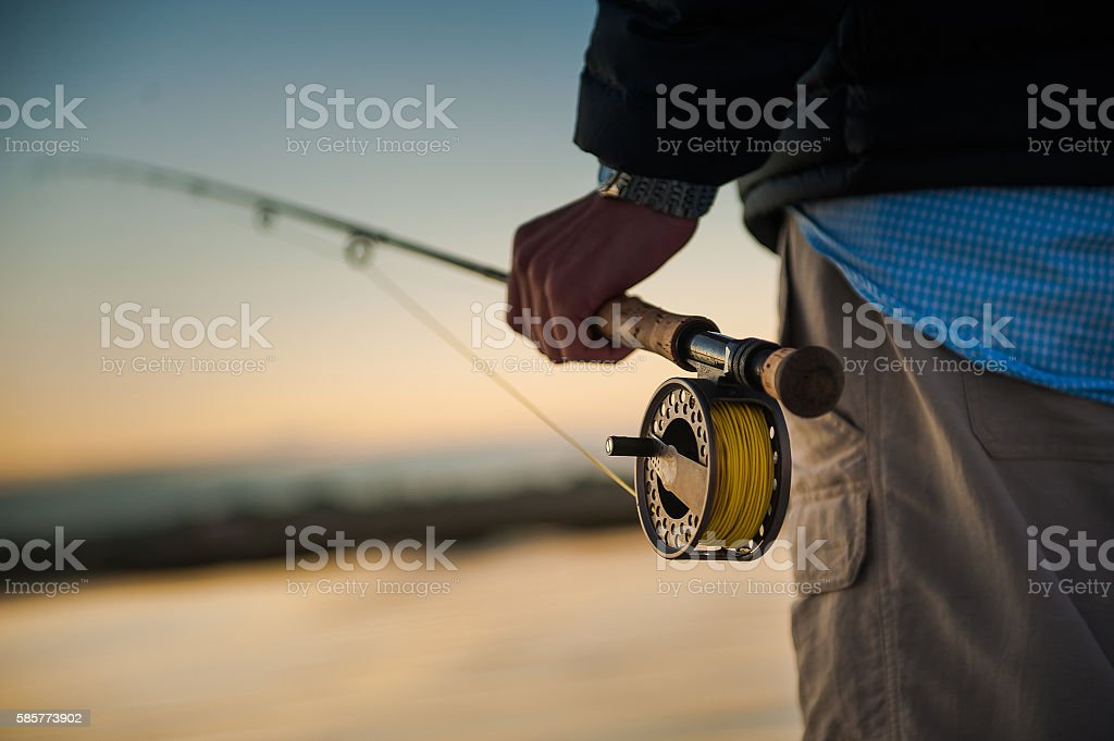 Man holding fly rod stock photo