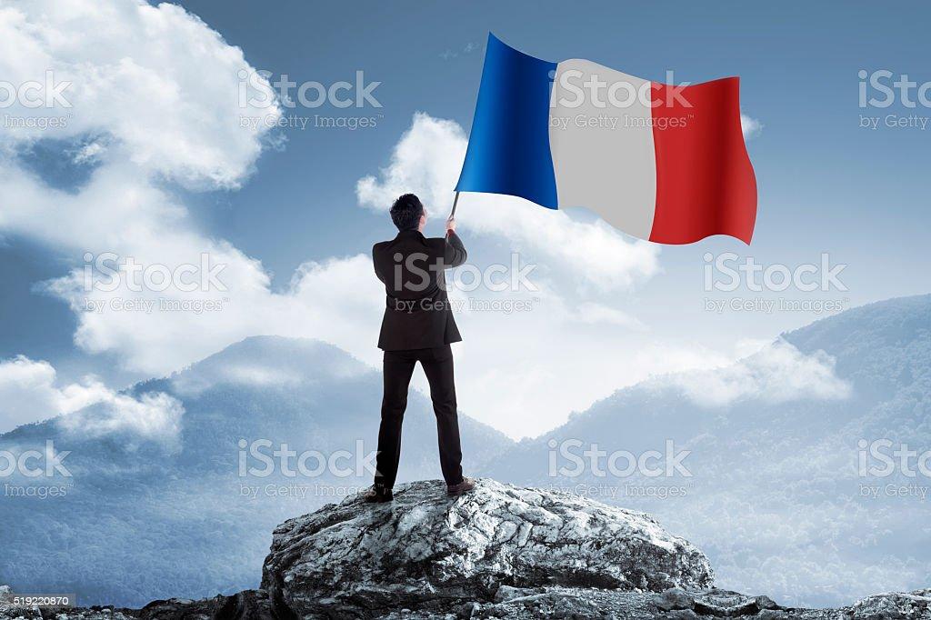 Man holding france flag stock photo