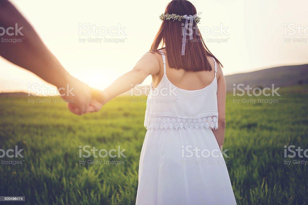 Man holding girl's hand stock photo