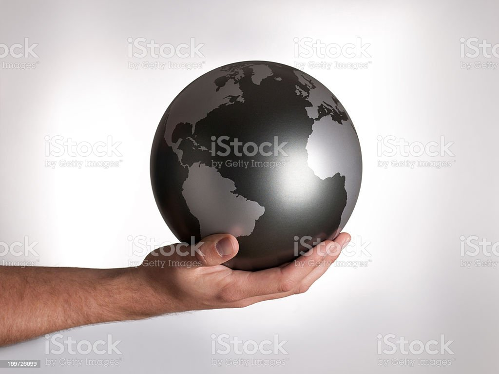 Man holding globe stock photo