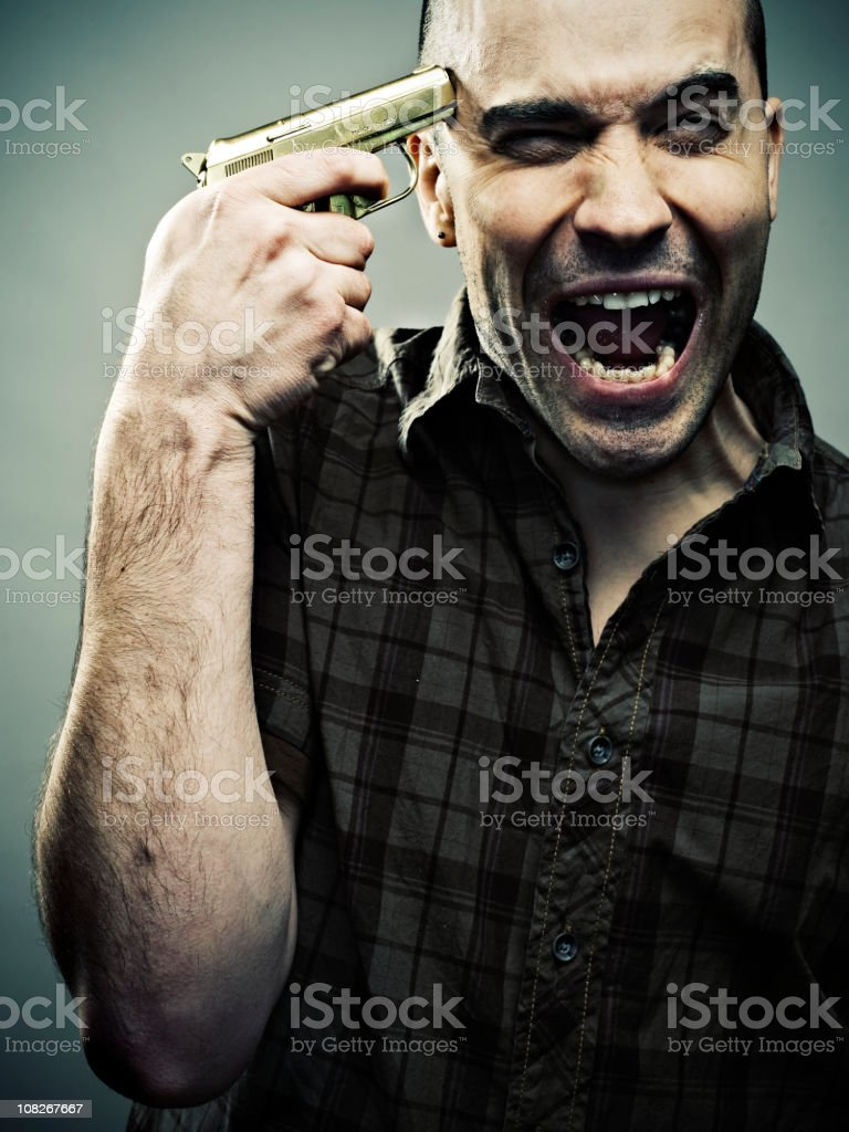 Man Holding Gold Handgun to Head royalty-free stock photo