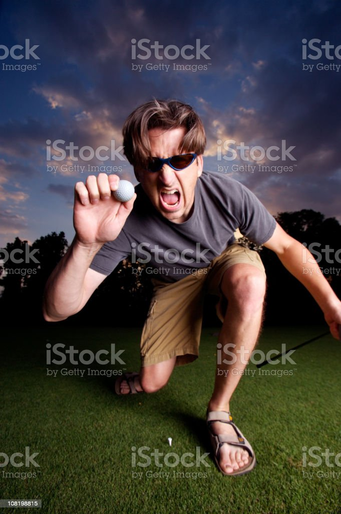 Man Holding Golf Ball royalty-free stock photo