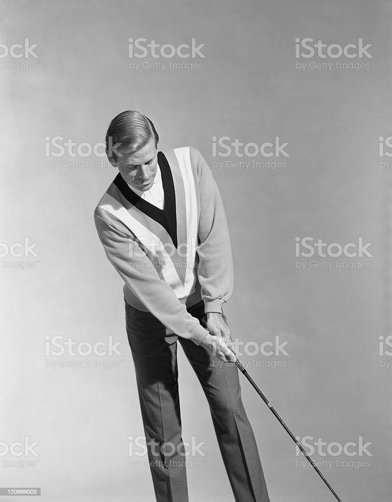 Man holding golf club stock photo