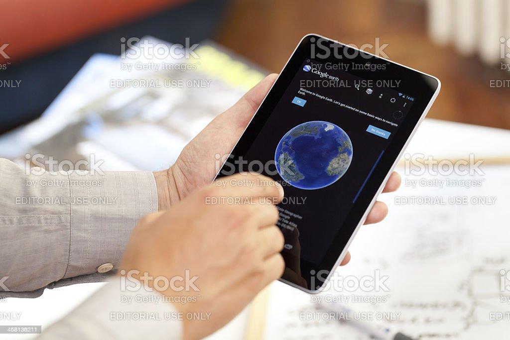 Man holding Google Nexus 7 Digital Tablet stock photo