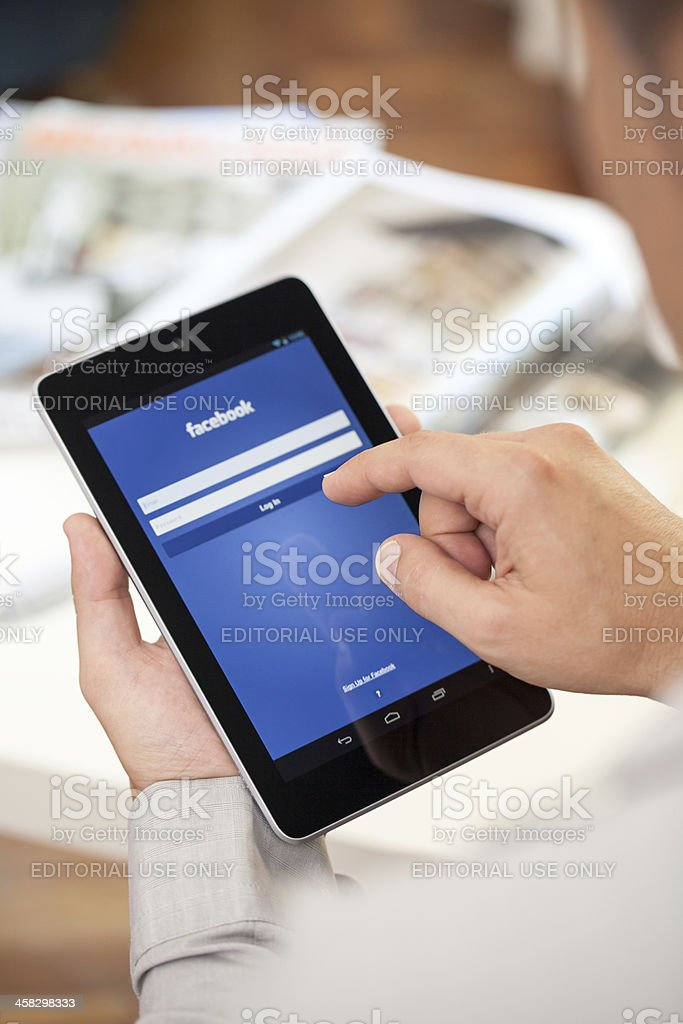 Man holding Google Nexus 7 tablet stock photo