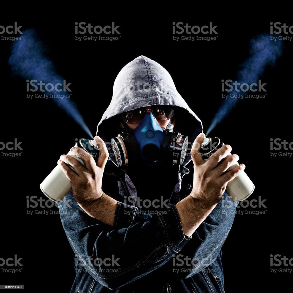 Man Holding Graffiti Spray Paint Cans stock photo