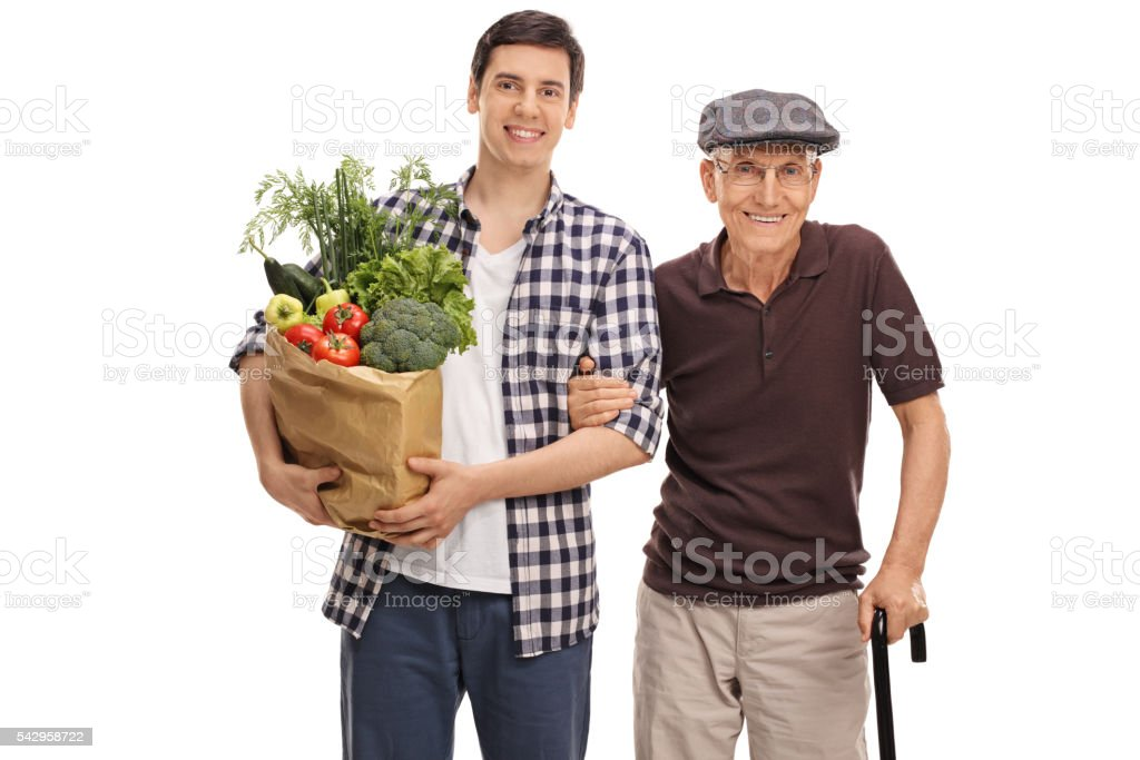 Man holding groceries with his grandpa stock photo