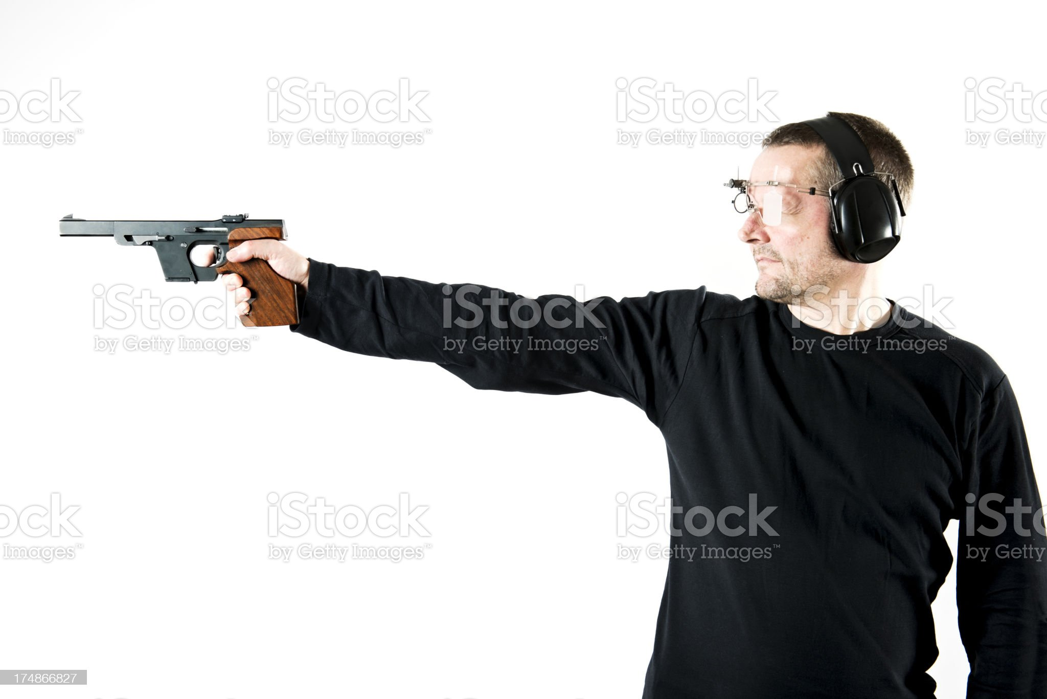 Man Holding Gun and Practicing Shooting royalty-free stock photo